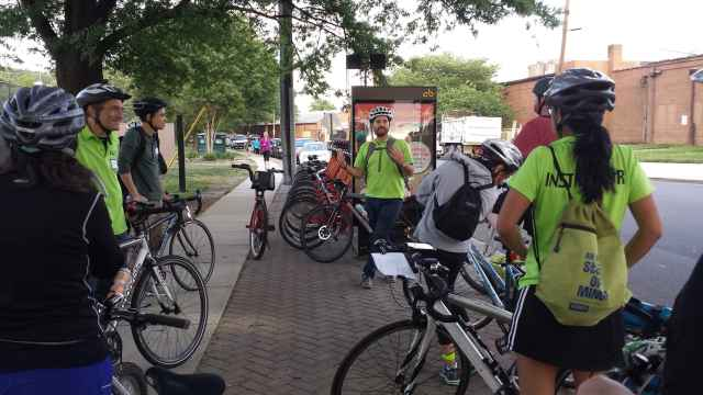 Education Coordinator Daniel Hoagland introduces the group to bike sharing.