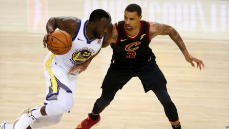 Golden State Warriors forward Draymond Green (23) drives against Cleveland Cavaliers guard George Hill (3) during the second half of Game 1 of basketball's NBA Finals in Oakland, Calif., Thursday, May 31, 2018. (AP Photo/Ben Margot)