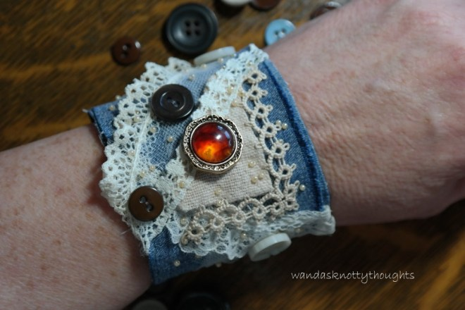 Wearing the denum cuff with tatting, lace, and buttons on wandasknottythoughts
