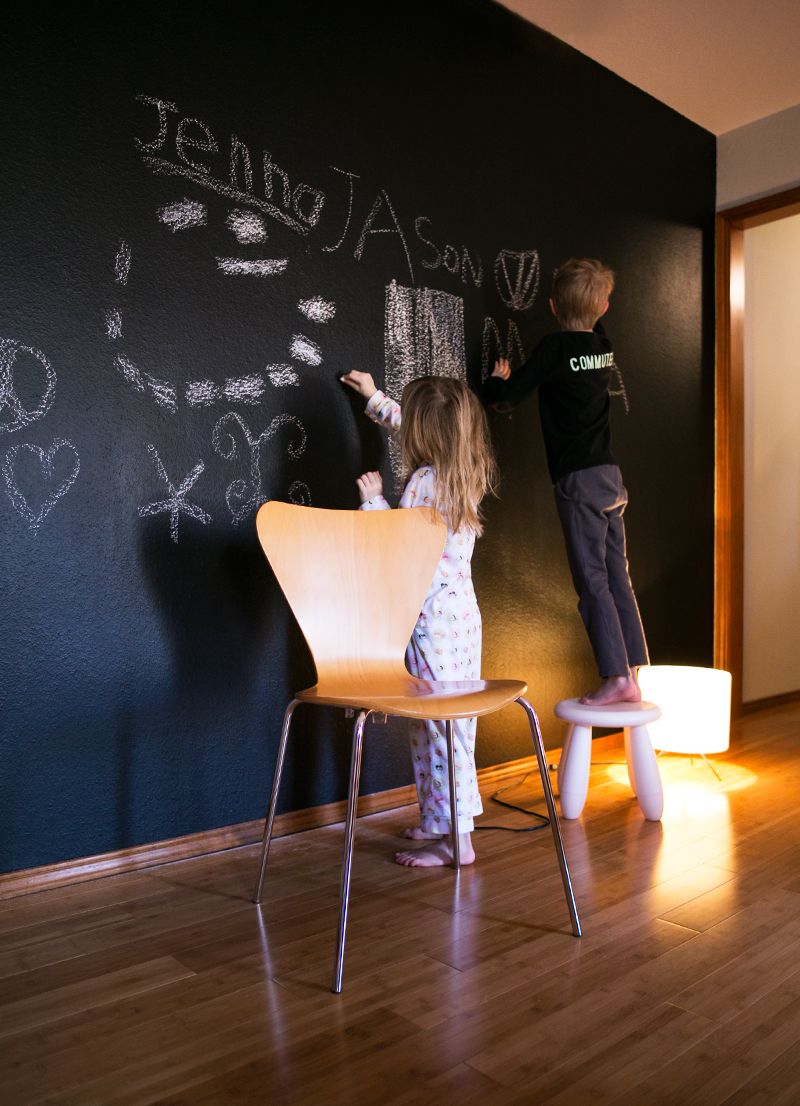 Creating a chalkboard accent wall in a girl's bedroom. Such a great design for someone who loves to draw.