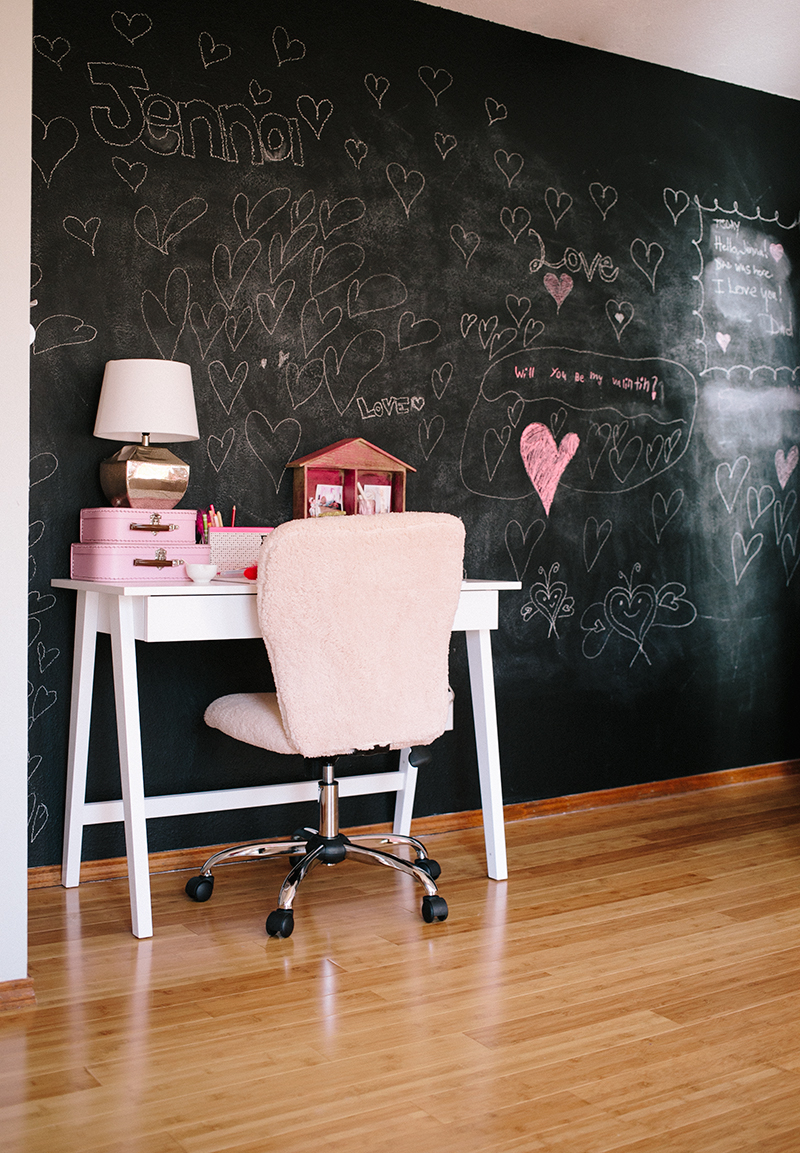 Girls bedroom with desk and chalkboard wall