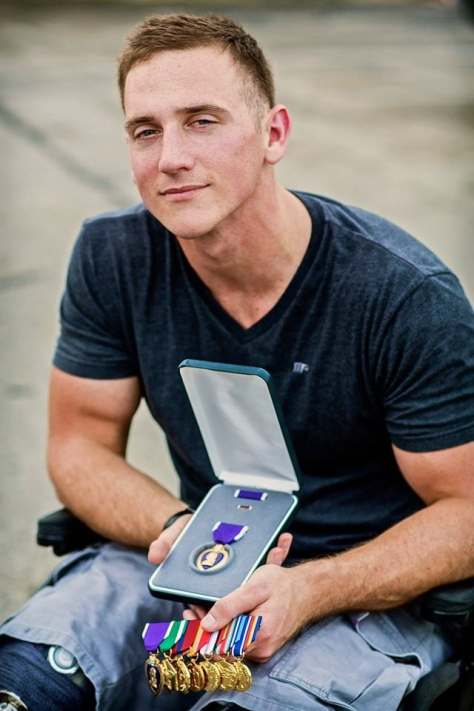 Marine Cpl. Michael Egan displays his Purple Heart, awarded for injuries sustained in Afghanistan. (Photos courtesy Michael Egan)