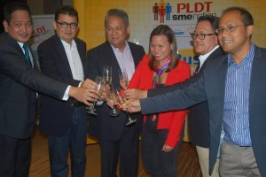 PLDT Executive Vice President and ePLDT President and CEO Eric Alberto,andf irst Vice President and head ofeSME Business Kat Luna-Abelarde with they are partnership Philippine Retailers Association,Go Negosyo,PNB and Google