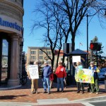 We Are Cove Point is greeted by media (in the far left) during a #DumpDominion action in Harrisonburg, Virginia.