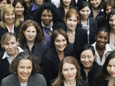group of diverse women looking at camera featured