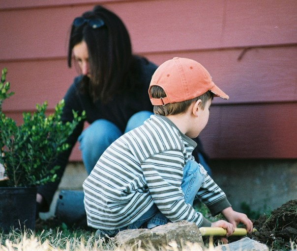 kid helping with gardening