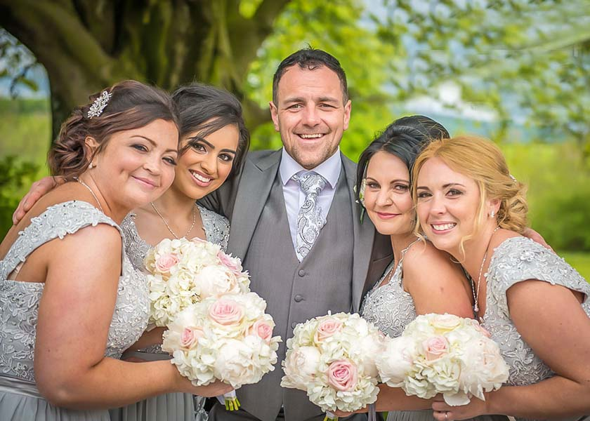 Groom and bridesmaids at Stirk House hotel