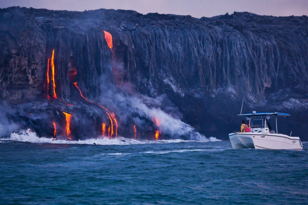 Big Island  Hawaii Insider s Travel Guide boat at shore dripping with lava  big island  hawaii