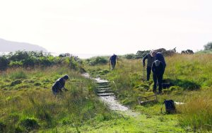 Volunteers hard at work clearing drainage and other general maintenance on the stretch of the 'West Island Way' leading to Glencallum Bay. (Picture by Billy Shields)