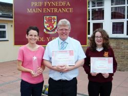Headteacher, Michael Davies, is pictured with Serena Davies and Grace Stangroome and the awards.