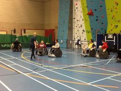 Enjoying a session of wheelchair rugby at the Disability insport Festival at Haverfordwest Leisure Centre.