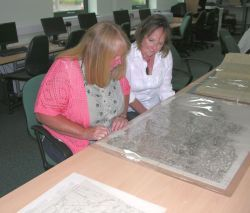 Jo Hutchings and Lynn Bush of Cardigan U3A Local History Group study the first Ordnance Survey map of Pembrokeshire.