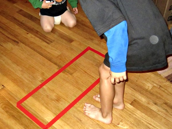 A tape shape on the floor makes amazing and simple entertainment for kids!
