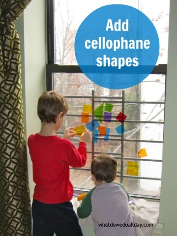 Make faux stained glass art on the window with cellophane shapes