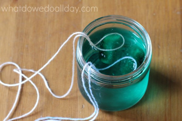 ice cube science experiment with salt and string