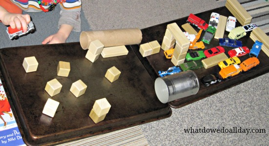 Homemade car ramp for toy cars with building block obstacle course