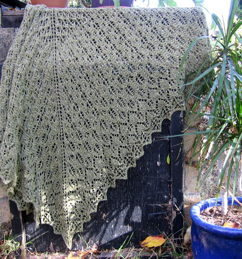 The Pangea shawl draped on the barbecue