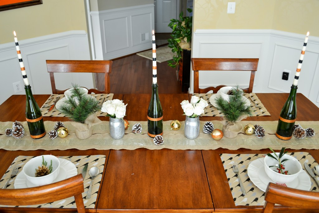 holiday tablescape with wine bottle candle holders