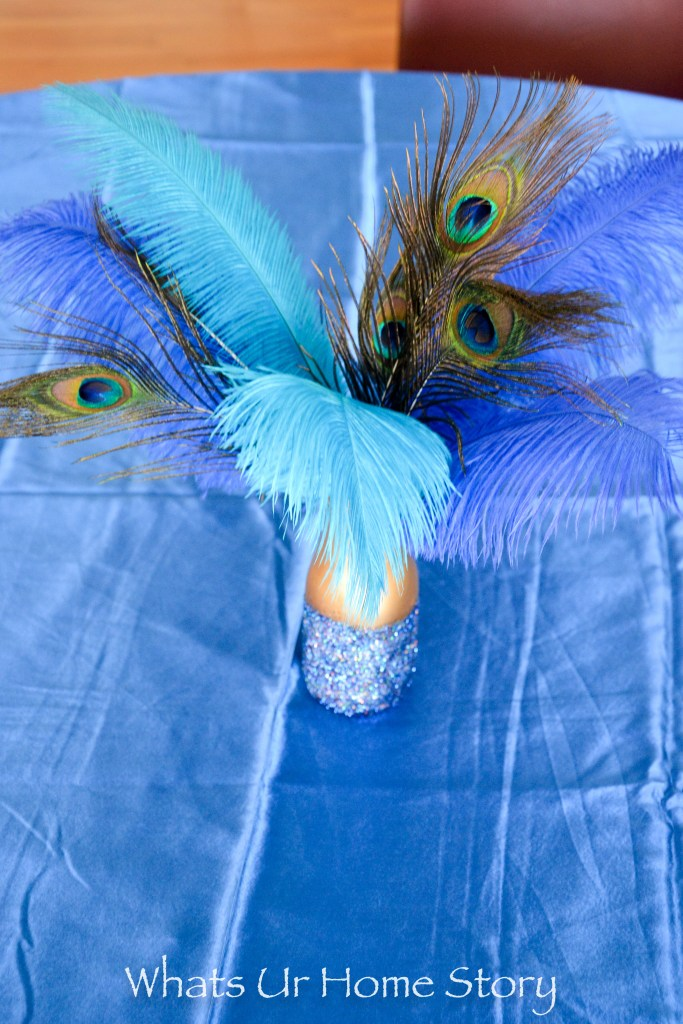 Easy and frugal decor for a peacock theme party- peacock centerpiece in diy glitter vases
