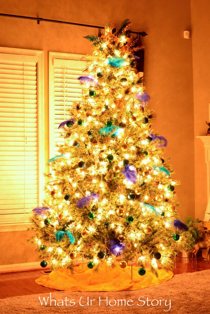 peacock-themed-christmas-tree-in-gold-blue-and-green-colors