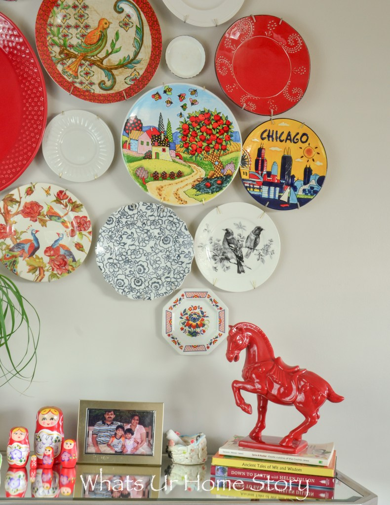 Plates from the thrift store hung on the wall to form a beautiful wall of plates