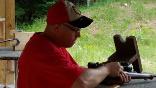 Dan loads his rifle