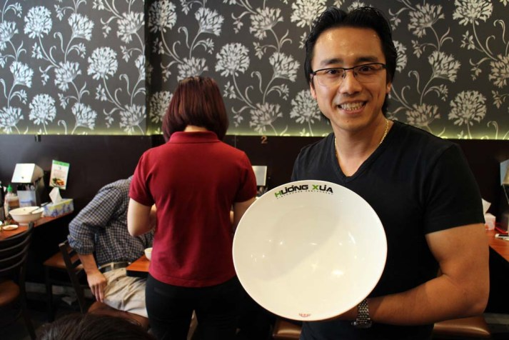 Cabramatta food, Huong Xua owner James Tran with Pho bowl
