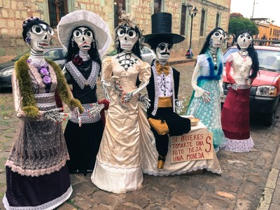 """{Day of the Dead is in the air. There was a little boy looking at this with uncertainty when we were there. I asked him, """"Que piensas?"""" - what do you think - and he just looked at me all wide-eyed and then looked back at the paper mache people as if they were the scariest weirdest things he had ever seen."""