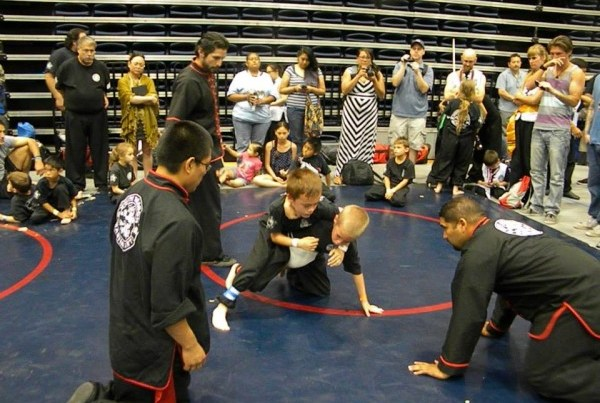 young students grappling