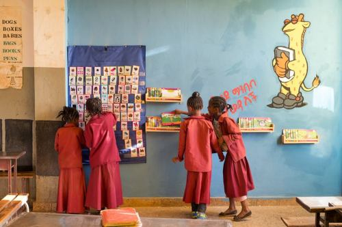 Children looking at Tsehai Reading corner materials in an Ethiopian school