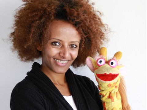 Brukty - Co-founder and CEO of Whiz Kids Workshop posing with Tsehai for the Tremplin Prize 2014