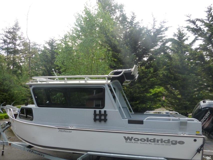 Rain fly custom aluminum boat tower who dat towers for Custom aluminum fishing boats