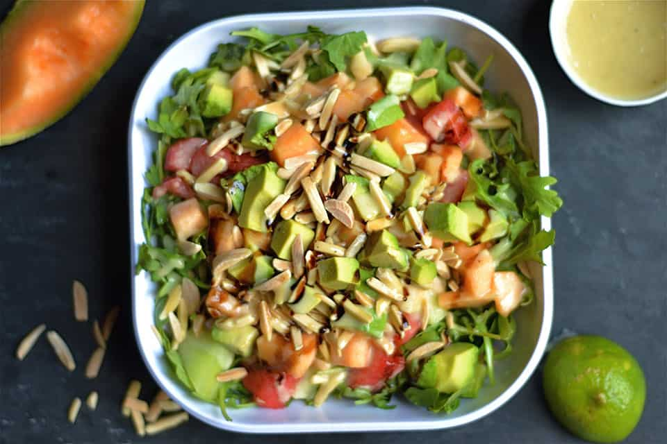 melon with sliced avocados and arugula, tossed with a tangy honey lime ...