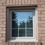 Sandelwood internal grills in a casement window