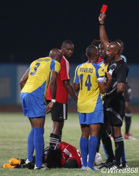 Photo: Defence Force midfielder Keston Williams (far left) is ejected by referee Neal Brizan (far right) while Central attacker Jason Marcano (on the ground) tries to shake off a wild tackle. (Courtesy Wired868)