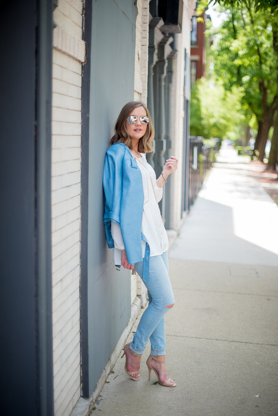 zara-blue-faux-leather-cropped-moto-jacket-white-flowy-blouse-light-blue-skinny-jeans-mossimo-tassel-canteen-bag-mirrored-aviators