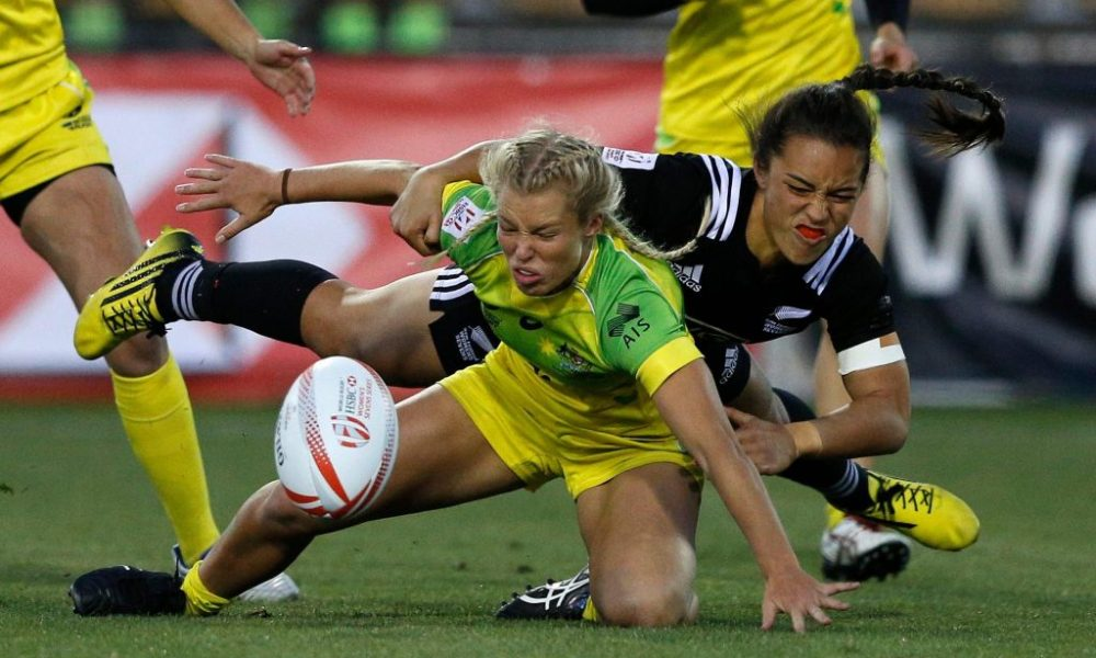 Emma Tonegato of Australia braces herself for New Zealand tackle in the final match at Atlanta 7s. Photo: Mike Lee @ KLC Fotos.