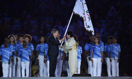 International Olympic Committee (IOC) President Thomas Bach (L) gives the Olympic flag to Tokyo's governor Yuriko Koike during the closing ceremony of the Rio 2016 Olympic Games at the Maracana stadium in Rio de Janeiro on August 21, 2016.  / AFP / Leon NEAL        (Photo credit should read LEON NEAL/AFP/Getty Images)