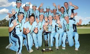 SYDNEY, AUSTRALIA - JANUARY 25:  NSW Breakers players pose with the trophy after winning the WNCL Final match between South Australia and New South Wales at Blacktown International Sportspark on January 25, 2015 in Sydney, Australia.  (Photo by Mark Metcalfe/Getty Images)