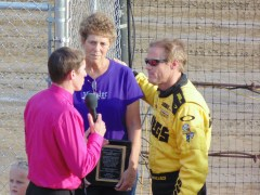 Kenny Wallace is pictured here with Marge Newton and Track Announcer Andrew Hayn who