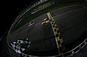 Jeff Gordon, driver of the #24 Axalta Coatings Chevrolet, takes the checkered flag to win the NASCAR Sprint Cup Series 5-Hour Energy 400 at Kansas Speedway on May 10, 2014 in Kansas City, Kansas. Photo by Todd Warshaw/NASCAR via Getty Images