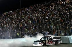 Darrell Wallace Jr., driver of the Toyota Toyota, celebrates with a burn out after winning the NASCAR Camping World Truck Series Drivin' For Linemen 200 at Gateway Motorsports Park on June 14, 2014 in Madison, Illinois. Photo by Todd Warshaw/NASCAR via Getty Images