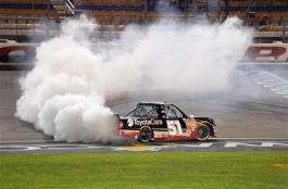 Erik Jones driver of the #51 ToyotaCare Toyota celebrates after winning the NASCAR Camping World Truck Series American Ethanol 200 presented by Enogen at the Iowa Speedway on July 11, 2014 in Newton, Iowa.  Photo by Robert Laberge/NASCAR via Getty Images