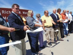 Governor Mike Pence and Congresswoman Jackie Walorski (far right) cut the ribbon to officially open U.S. 31 between Plymouth and South Bend