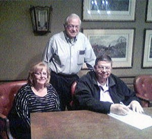 Seated: Dr. and Mrs. Walter Fritz; standing, Ron Vendl, president of the Starke County Historical Society.