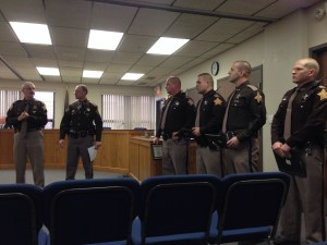 Sheriff Tom Chamberlin (L) recognizes officers for their extra effort in the line of duty.