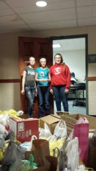 Stephanie Shepard, Sarah Clemons and Jake Skorup help gather donations at the Bluegrass Jam
