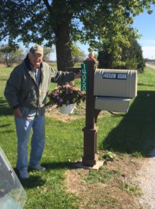 Kankakee Valley REMC member, Harry Lindstrom Jr. enjoyed receiving his new mailbox sign courtesy of Kankakee Valley REMC employees during Community Day.