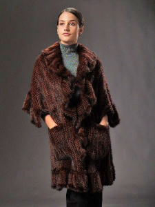 Frontview - Knitted, ruffled mink wrap with pockets.