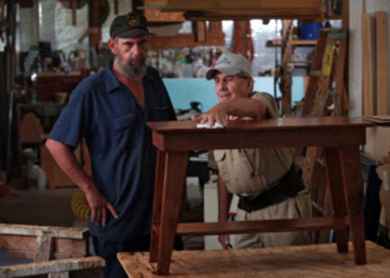 Ricky Hatfield, left, learns the art of woodworking from Ralph Jones. Hatfield, 42, lost his job as a truck driver, the only career he has had. He said he is enjoying learning the new trade.